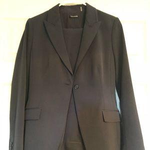 Tahari navy blue woman's suit.